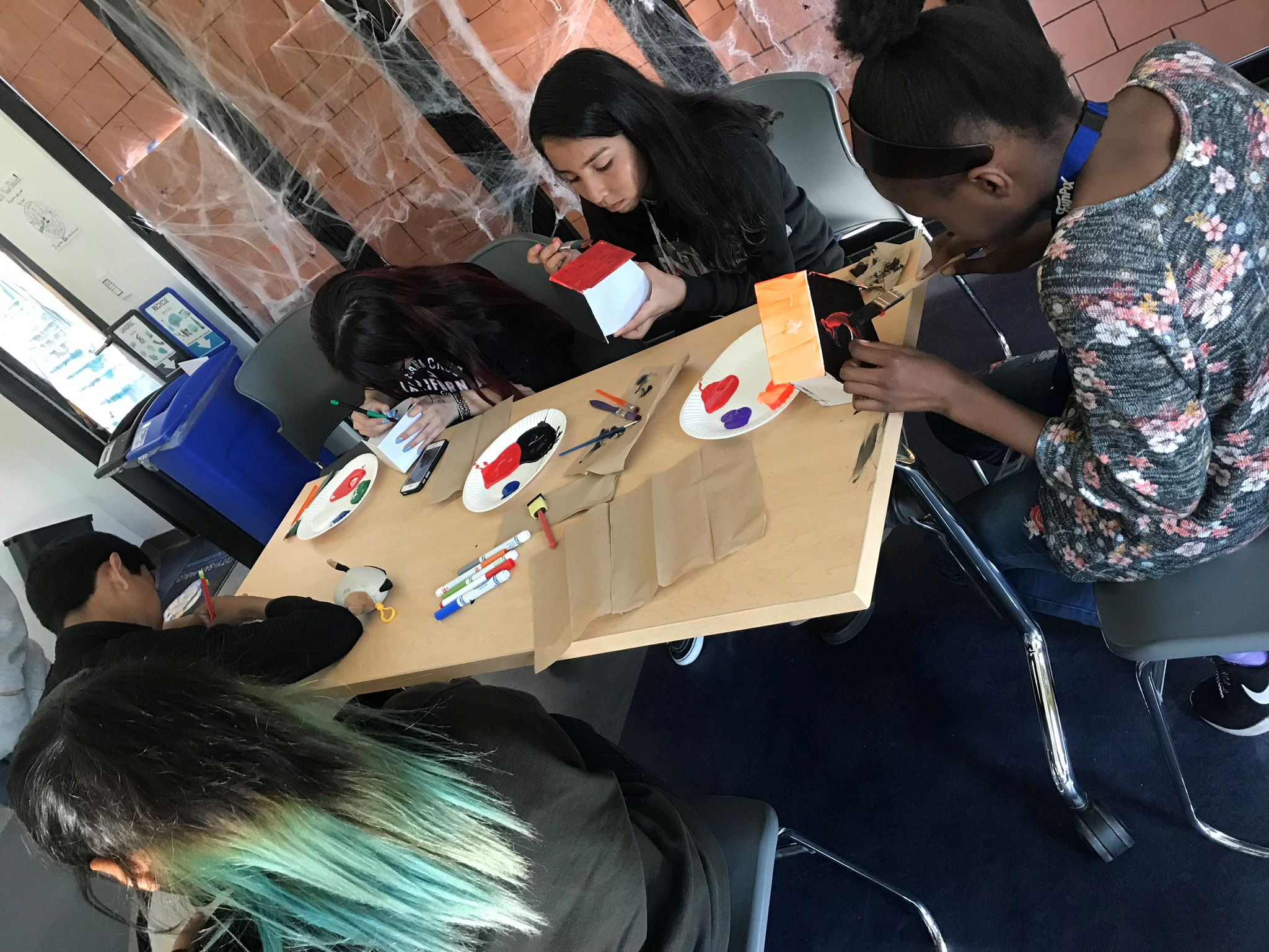 Teen Participants painting Halloween Houses