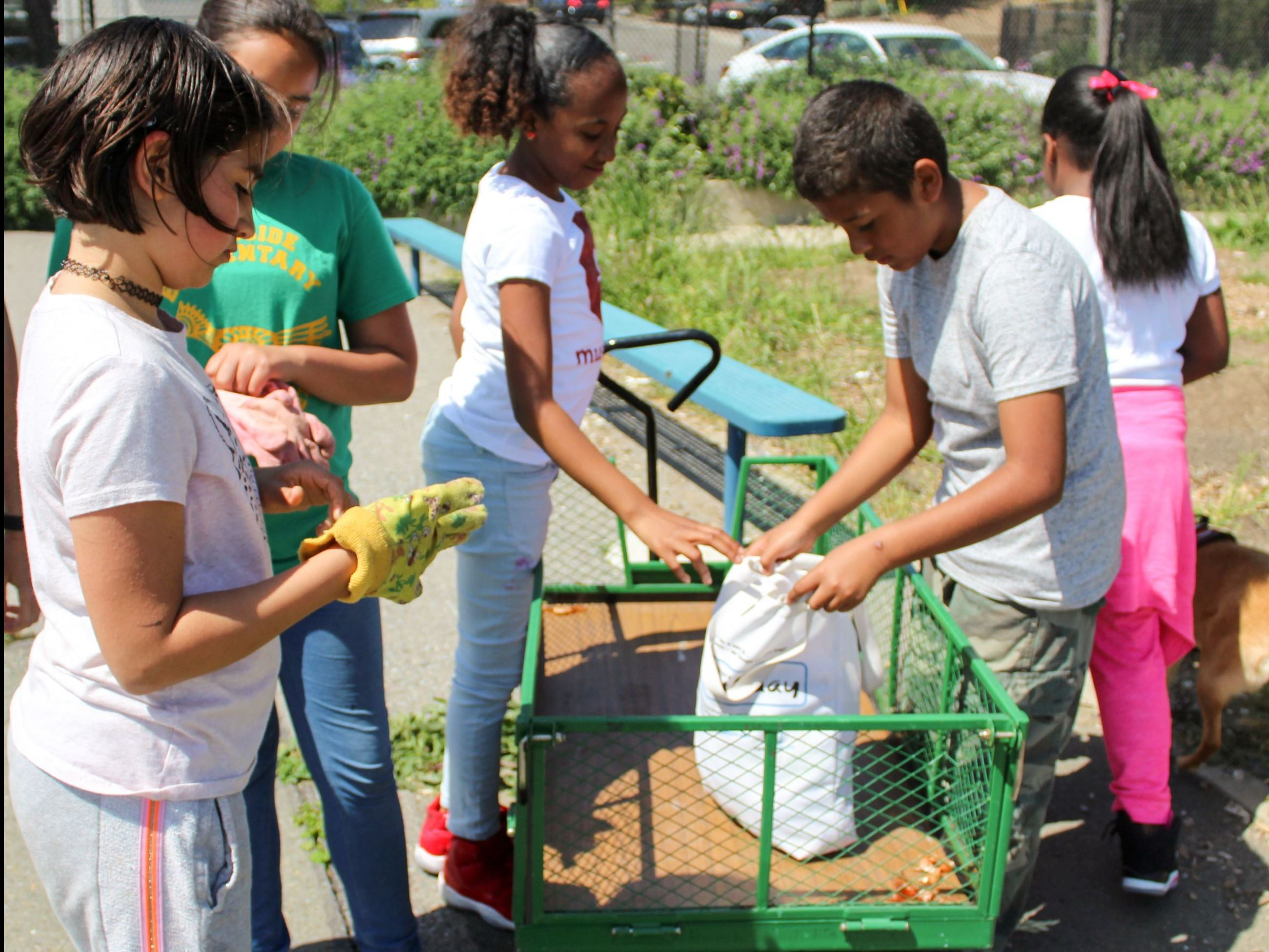 Students Participating in Gardening Group at Riverside Elementary