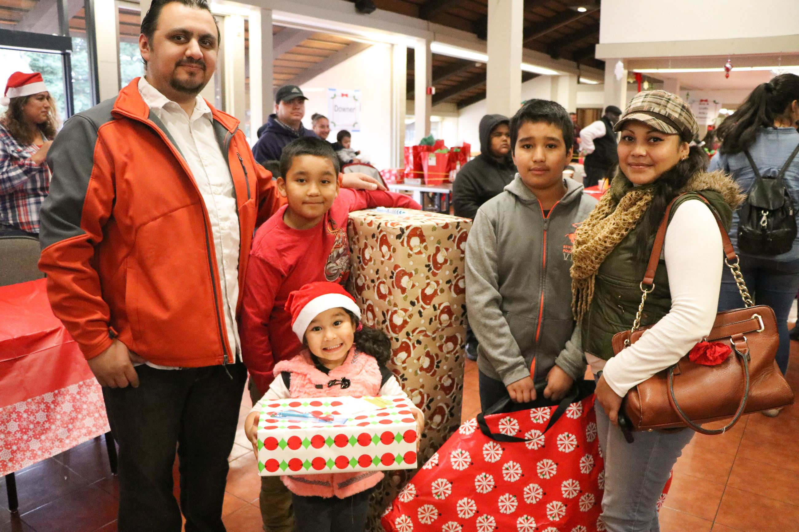 Family Receiving Gifts during Family Giving Tree Event